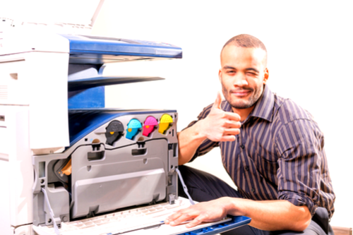 Man giving thumbs up after fixing printing