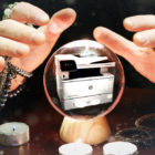 Woman scrying a crystal ball with printer inside