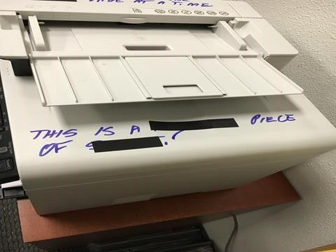 Printer with writing on it